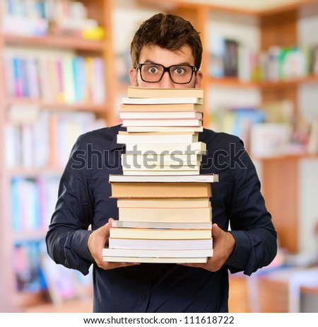 Young Man Holding Books, Indoor
