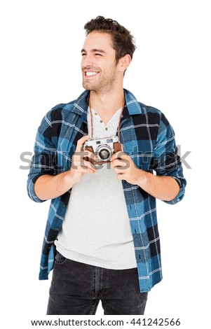 Young man holding camera on white background - stock photo