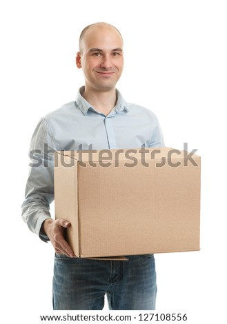 Young man holding cardboard box - stock photo