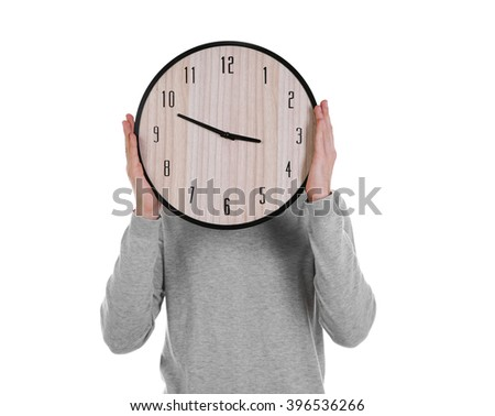 Young man holding clock, isolated on white