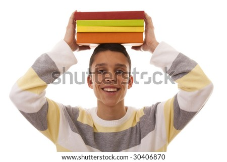 young man holding color books over his head