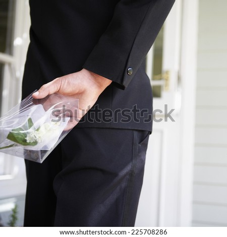 Young Man Holding Corsage for Prom Date - stock photo