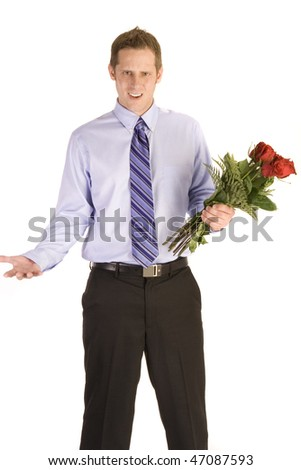Young man holding flowers looking rejected on white.