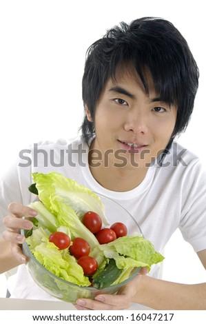 Young man holding fresh salad - stock photo
