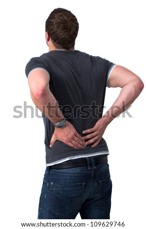 Young man holding his back in pain - stock photo
