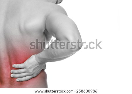 Young man holding his back in pain, isolated on white background - stock photo