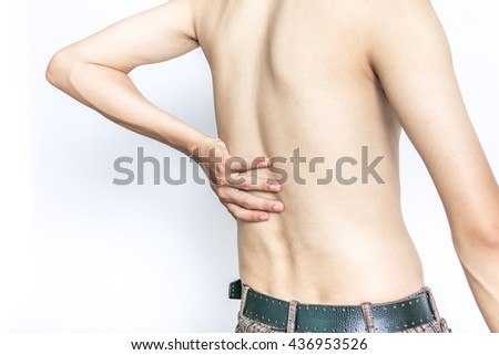 Young man holding his back in pain, isolated on white background