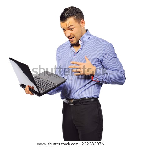Young man holding laptop with surprised expression isolated on white  - stock photo