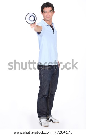 Young man holding Megaphone - stock photo