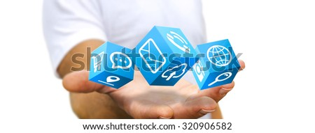 Young man holding modern cube interface in his hand - stock photo
