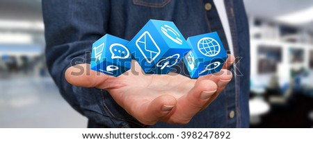 Young man holding modern digital icon application in his hand - stock photo