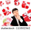 Young man holding money and thinking about gift. He is preparing for party or birthday or romantic dating. - stock photo