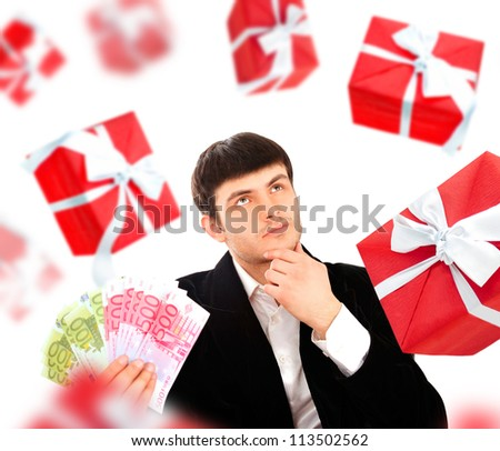Young man holding money and thinking about gift. He is preparing for party or birthday or romantic dating.