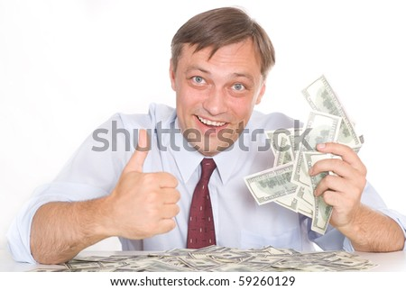 young man holding money on white - stock photo
