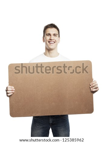 young man holding placard on a white background - stock photo