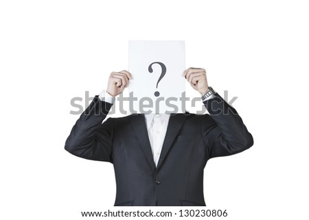 Young man holding question mark signboard paper in front of face