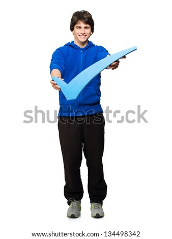 Young Man Holding Tick Mark Isolated On White Background - stock photo