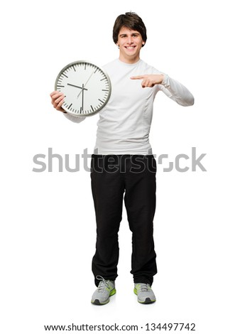Young Man Holding Wall Clock Isolated On White Background - stock photo