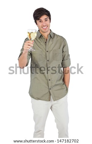 Young man holding wine glass and looking at the camera - stock photo