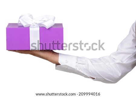 Young man holds a box with a gift, isolated on white background - stock photo