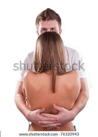 Young man hugging his girlfriend from the back - stock photo