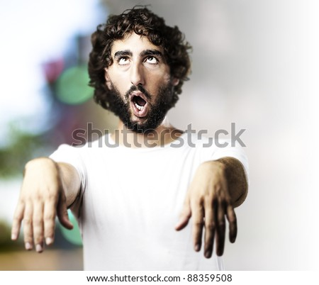 young man imitating a zombie at city - stock photo