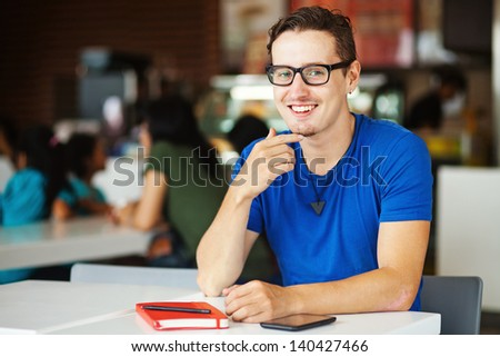 Young man in a cafe - stock photo