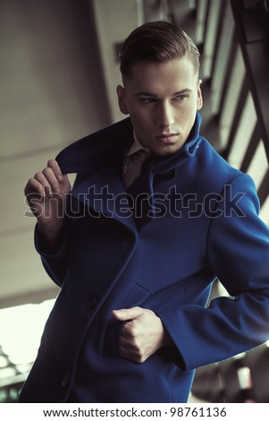 Young man in a fashionable coat
