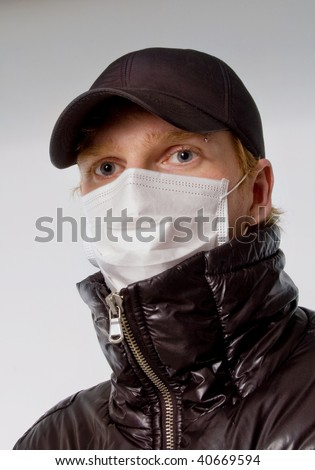 young man in a medical mask