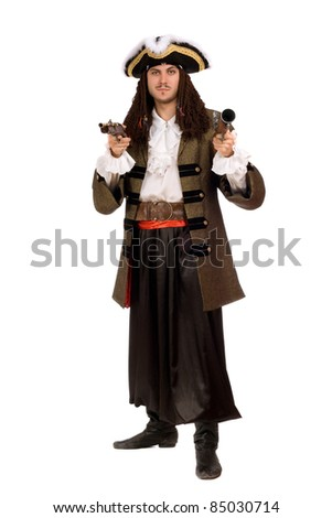 Young man in a pirate costume with pistols. Isolated