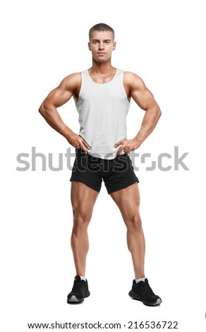 young man in a sports shirt, shorts and sneakers isolated on white background - stock photo