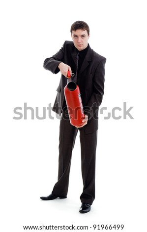young man in a suit holding a fire extinguisher, isolated on a white background.