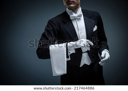 Young man in a tuxedo - stock photo