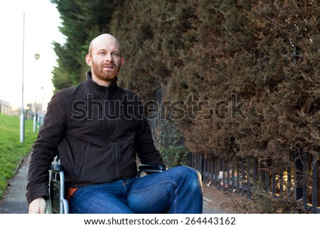 young man in a wheelchair - stock photo