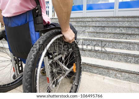 young man in a wheelchair in front of the stairs
