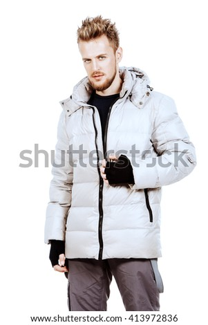 Young man in a winter jacket. Isolated over white. - stock photo