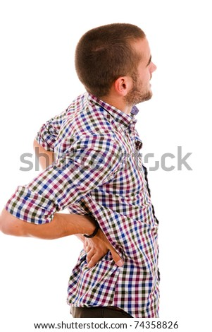 young man in agony with back pain, isolated on white - stock photo