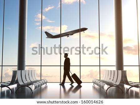 young man in airport and airplane in sky - stock photo