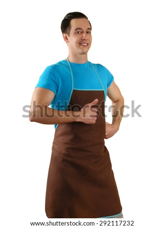 young man in an apron showing hand with raised thumb - stock photo