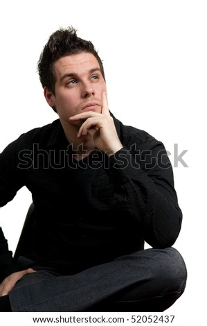 Young man in black clothes sitting on a chair and thinking, isolated on white - stock photo