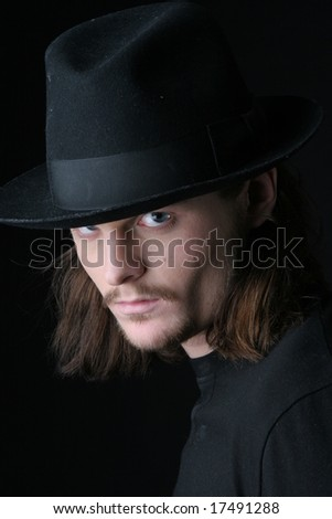 young man in black hat with blue eyes