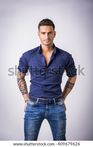 Young man in blue shirt and jeans isolated - stock photo