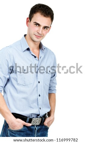 Young man in blue shirt and jeans, portrait of sexy guy looking at camera over white background