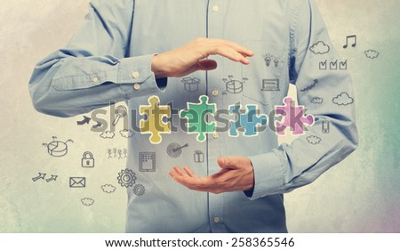Young man in blue shirt holding business creativity concepts - stock photo