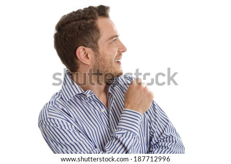 Young man in blue shirt looking sideways isolated on white background - stock photo