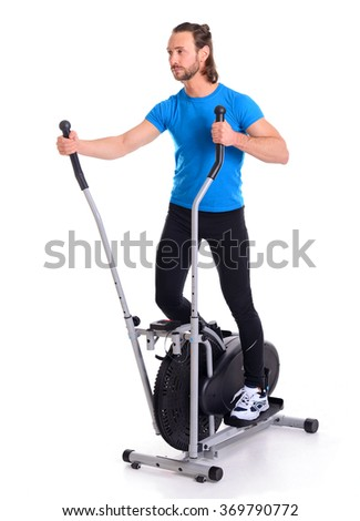 young man in blue shirt train with fitness machine - stock photo