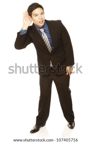 Young man in business attire cupping his ear and ready to listen