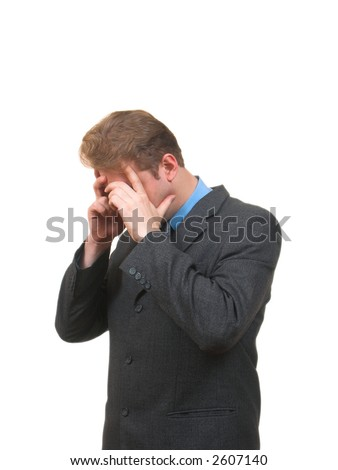 Young man in business suit hiding his face in palms isolated on white - stock photo
