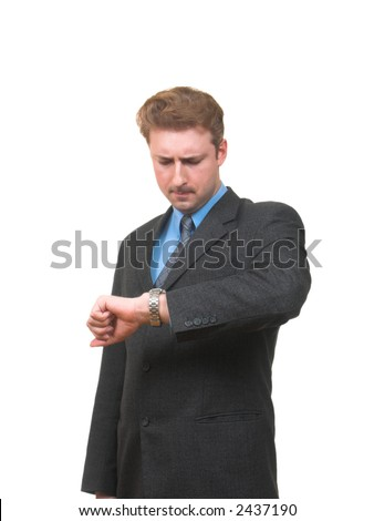 Young man in business suit looking at his watch for time frowning isolated on white