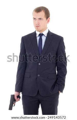 young man in business suit with handgun isolated on white background - stock photo